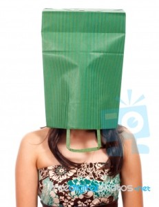 ashamed-girl-with-a-bag-on-her-head-10054806