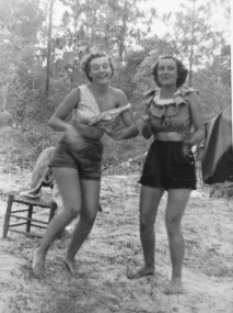 Aunt Betty Jo (left) and my mom (right) dancing barefoot in the sand.